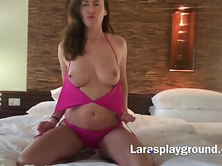 Solo wife Lara enjoys fingering her wet pussy on the bed. Webcam
