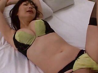 Closeup dusting of a foxy Japanese girl in stockings riding a dick